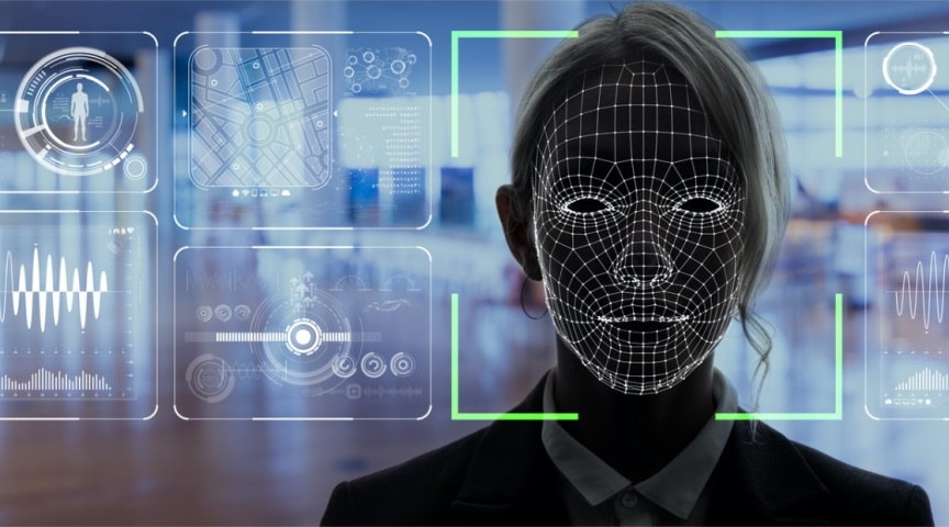A woman's face being captured and analyzed by facial recognition video security software.