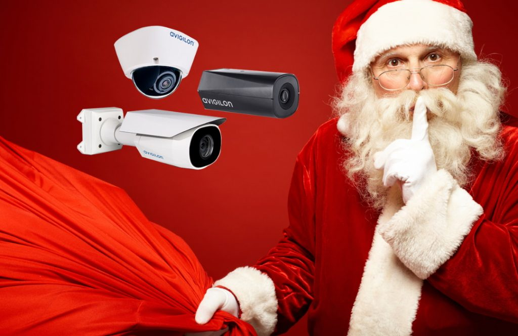 three video cameras pointing at Santa holding his bag