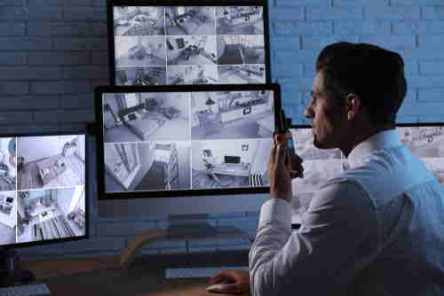 Man providing voice down commands through managed video security networks