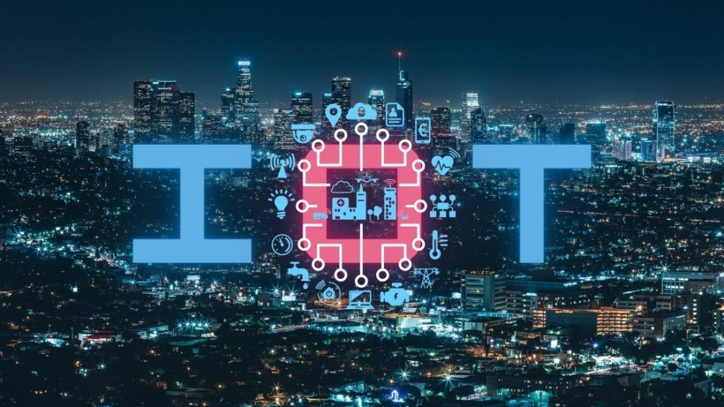 IoT in the forefront of a smart city at night